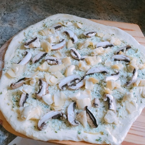 artichoke mushroom pizza ready for oven