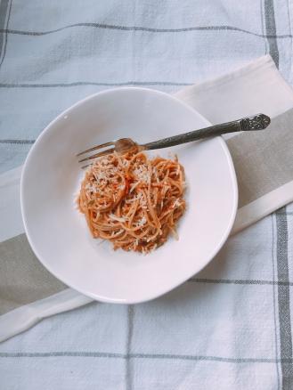 plated fresh roasted tomato & walnut pesto
